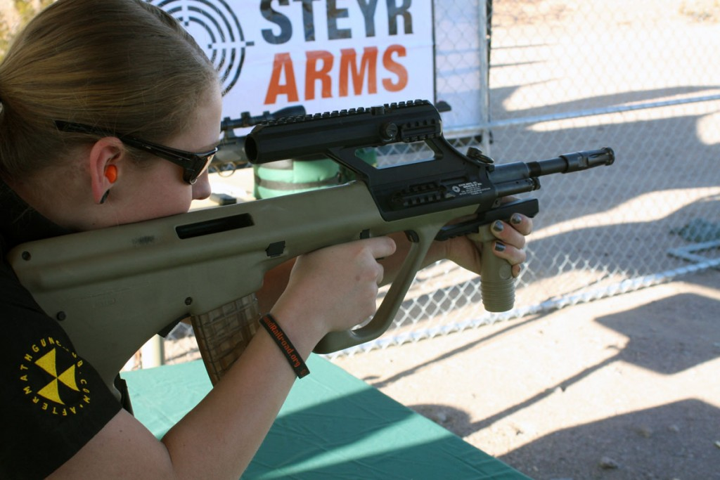 GunDoll at SHOT Show 2014 with Steyr AUG A3 M1 with optic