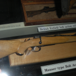 Miniature Mauser below a miniature Enfield, these are functioning firearms.
